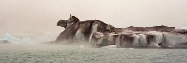 Iceberg on glacial lake by navigatornick