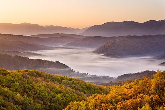 Mist at sunrise by Lizzie_Shepherd