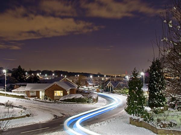 Snowy street scene by Ian G W
