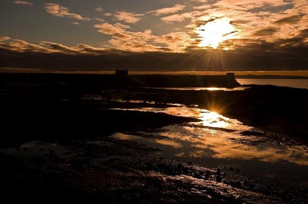 Dawn breaks oer Saltcoats Harbour by colmar