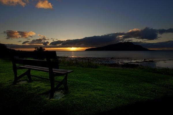 Sunrise over Holy Isle by AlanGrahamCoUk