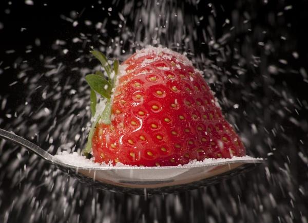 strawberry with a rain of sugar by SusanDavison