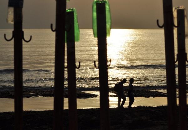 A walk along the beach by Markus_Brehm