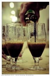 pouring black elixir