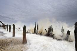 Waves crashing on to beach.