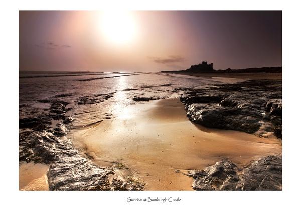 Sunrise at Bamburgh Castle by brianquinn