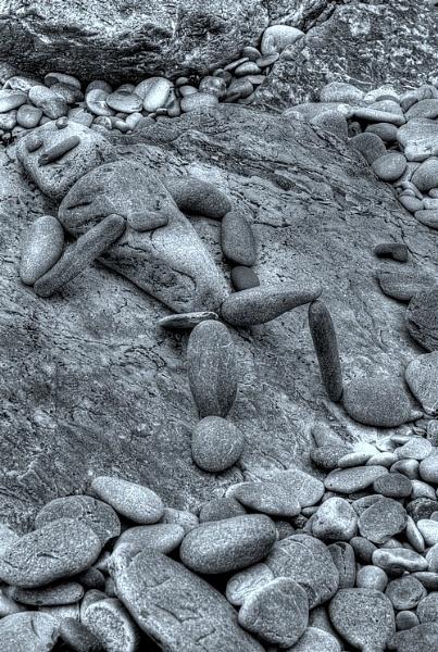 Stone man having a lie down by pentaxboy