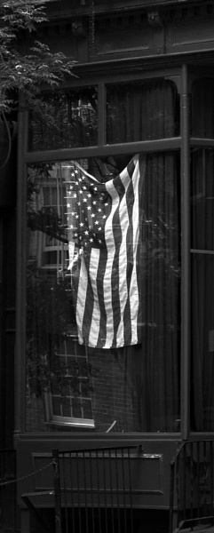 Flag in window by RobArtphoto