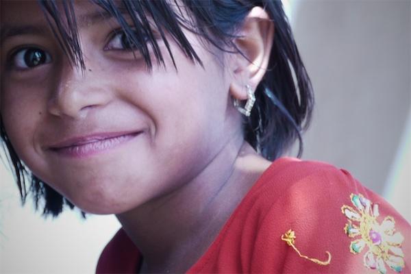 portrait of a village girl by handheldFilms