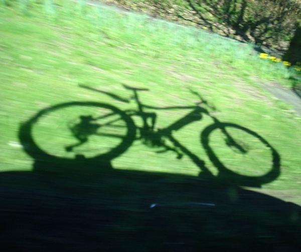 speeding bike shadow by dixy