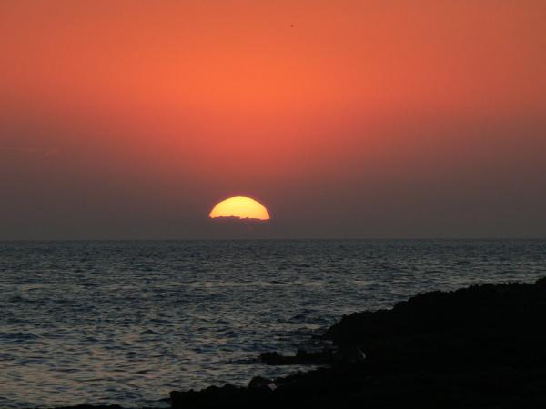 Sunset over Ibiza by eddie1