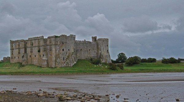 Stormy skies over Carew Castle by JohnBee