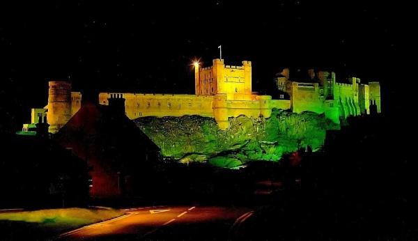 Bamburgh Castle at night by nazimundo