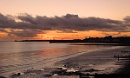 Sunset over Castletown Beach by last ten