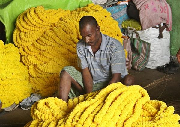 Man in a flower market by PradyothChakraborty