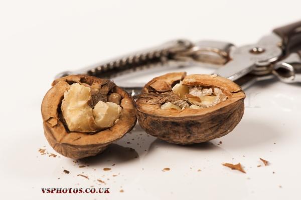 Cracking walnut by vsphotos