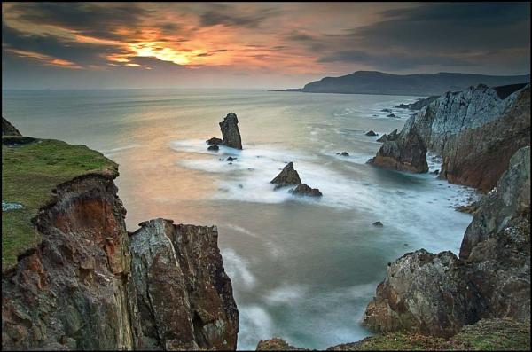 Sun down over Achill by bombolini