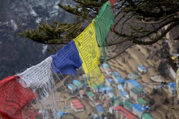 Prayer flags over Namche Bazar by harlequinarcher
