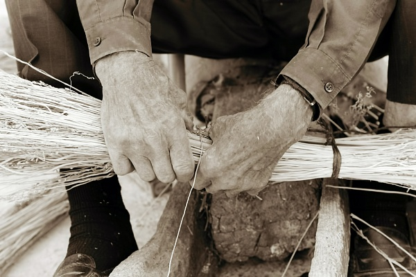Old man making a broom by aeras