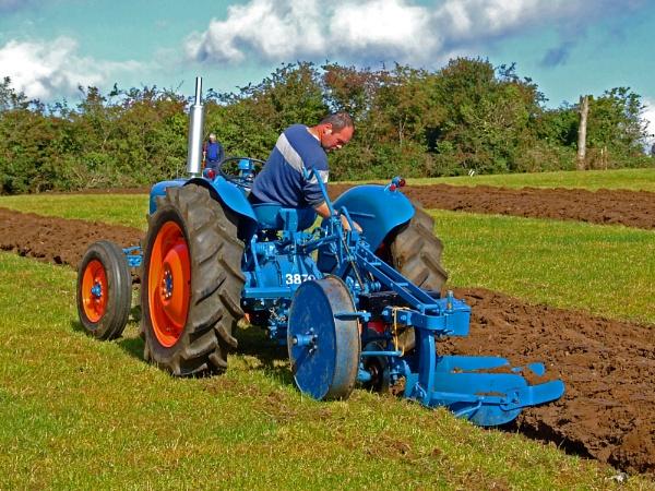 Ploughing the field by canonfan