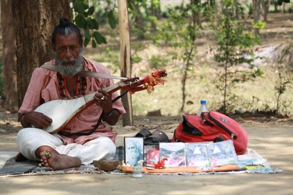 The roadside musician. by PradyothChakraborty