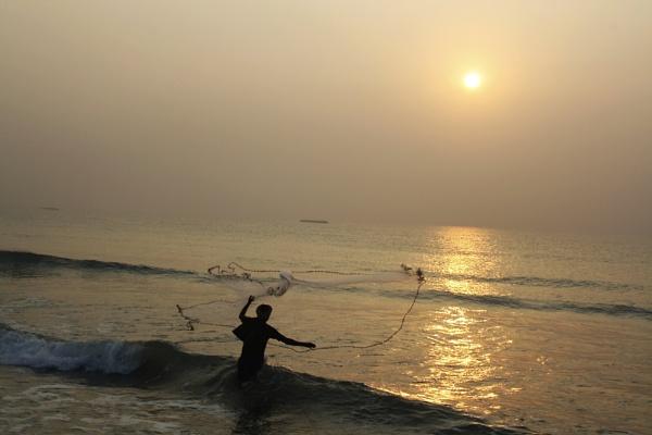 Fishing at dusk. by PradyothChakraborty