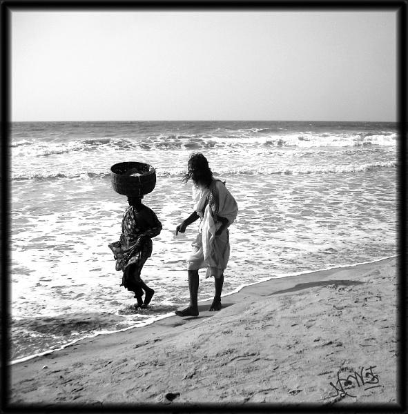 Walking on beach by Sushanta