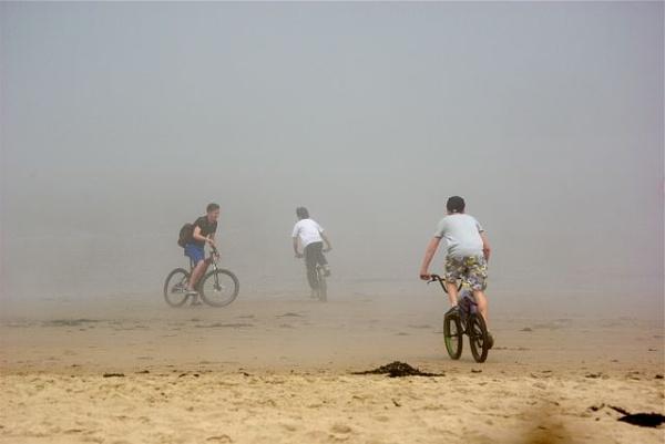 Fun on a misty beach. Cresswell, Northumberland by Mwande