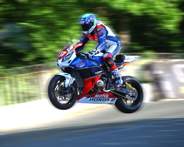 2012 TT racer Si Andrews at Ballaugh Bridge by robsriverview