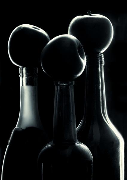 Apples on bottles by reflectionsinlight