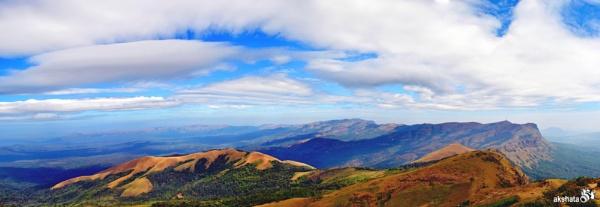 The Brownish-Green Hiking peaks of Mullayanagiri kissing the blue sky. by akshatashagoti