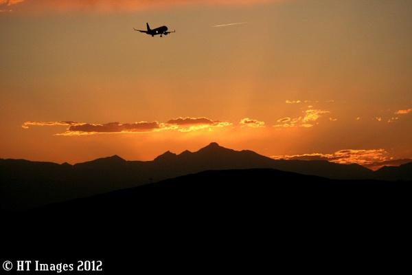 Landing at Sunset by Harlan