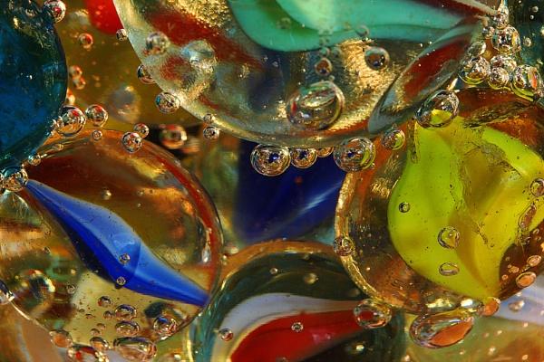Marbles in spring water by macro60