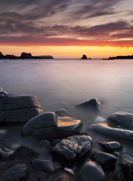 Sunset at Ballintoy by garymcparland