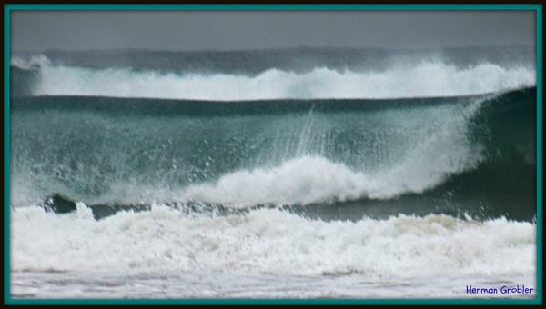 Thundering waves by Hermanus