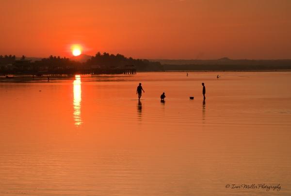 sunset in the philippines by tattsdurham