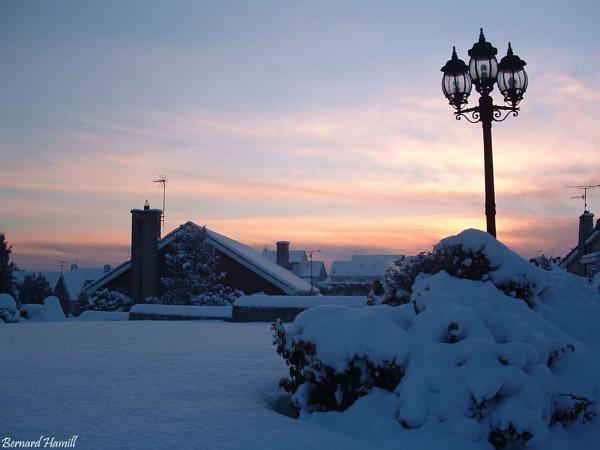 Snowy Sunset by barn yard