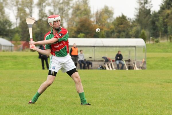 Lisnaskea Hurley Player, Paul McGoldrick, on the ball by Stevies