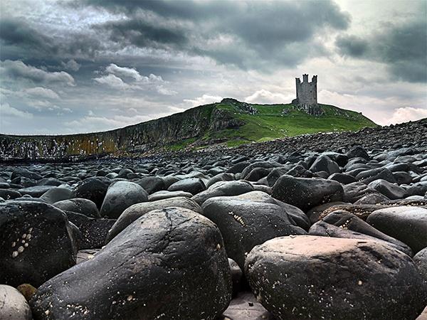 Dunstanborough Castle rocks by SteveMcHale