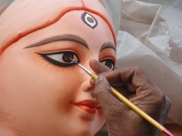 Giving  eye of a Durga Idol by a Kumortuli Artist of Kolkata ,West Bengal,India. by ARGHYASIKDAR