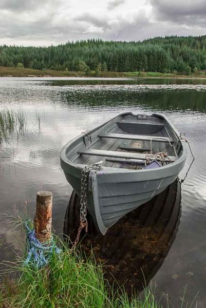 Boat at Rotmell Loch  near Dunkeld. by Osool