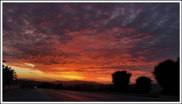 Sunset sky over Mosta (Malta) by alistairfarrugia