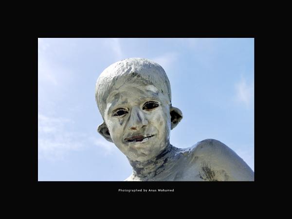 Boy in white by mute