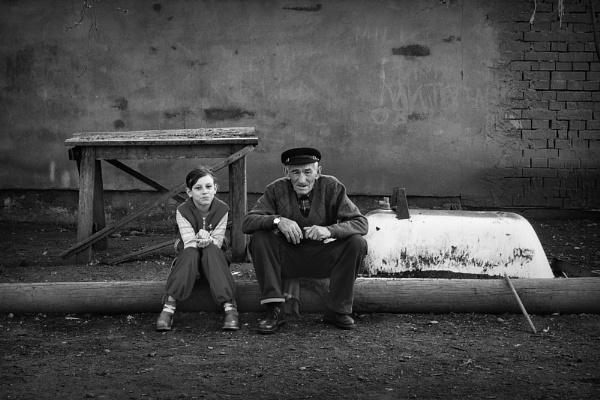 Grandfather and granddaughter by GoranStamenkovic