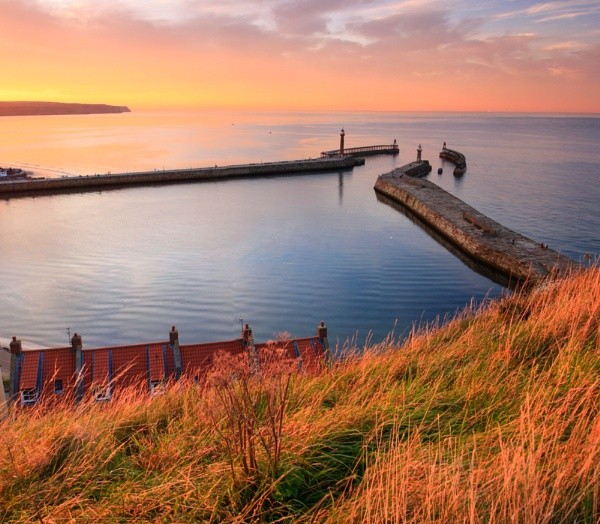 The Whitby Piers at sunset by smartiemart