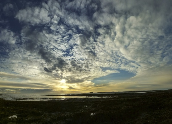 Clouds over Dunstanburgh by arodmell
