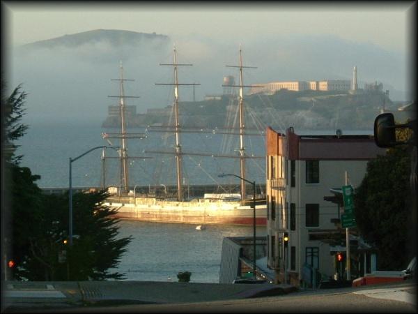 Boat in San Francisco Alcatraz in the distance by Chrisjaz