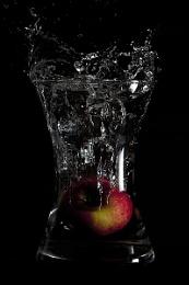 Falling apple in water.