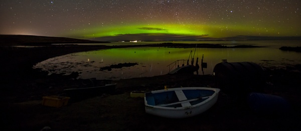 aurora over small boat by ireid7