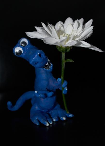 T-Rex offers a flower